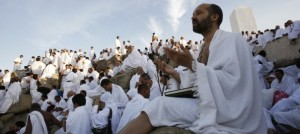A Muslim pilgrim prays on Mount Mercy on the plains of Arafat outside the holy city of Mecca