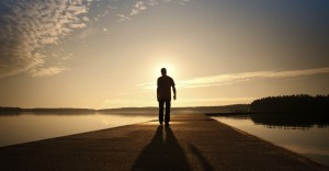 13235-man-alone-walks-water-path-road-sky-clouds-horizon.1200w.tn